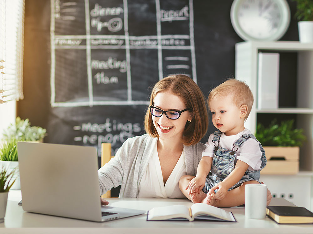 Mother with child whilst online learning
