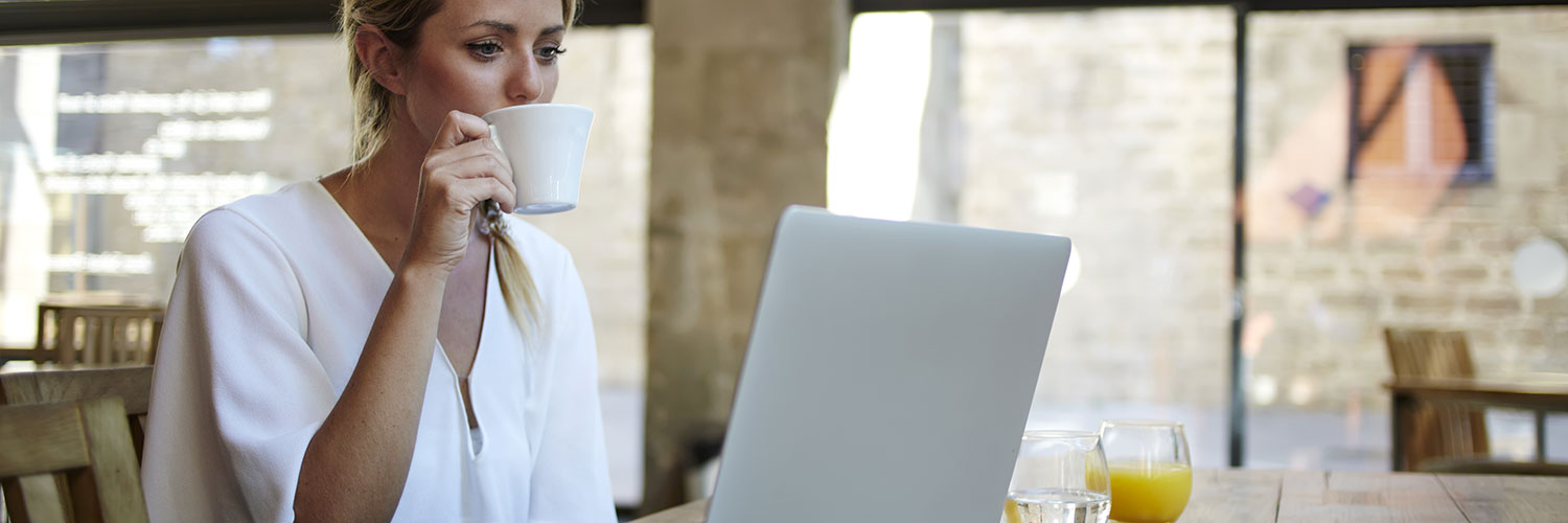Woman online learning drinking coffee